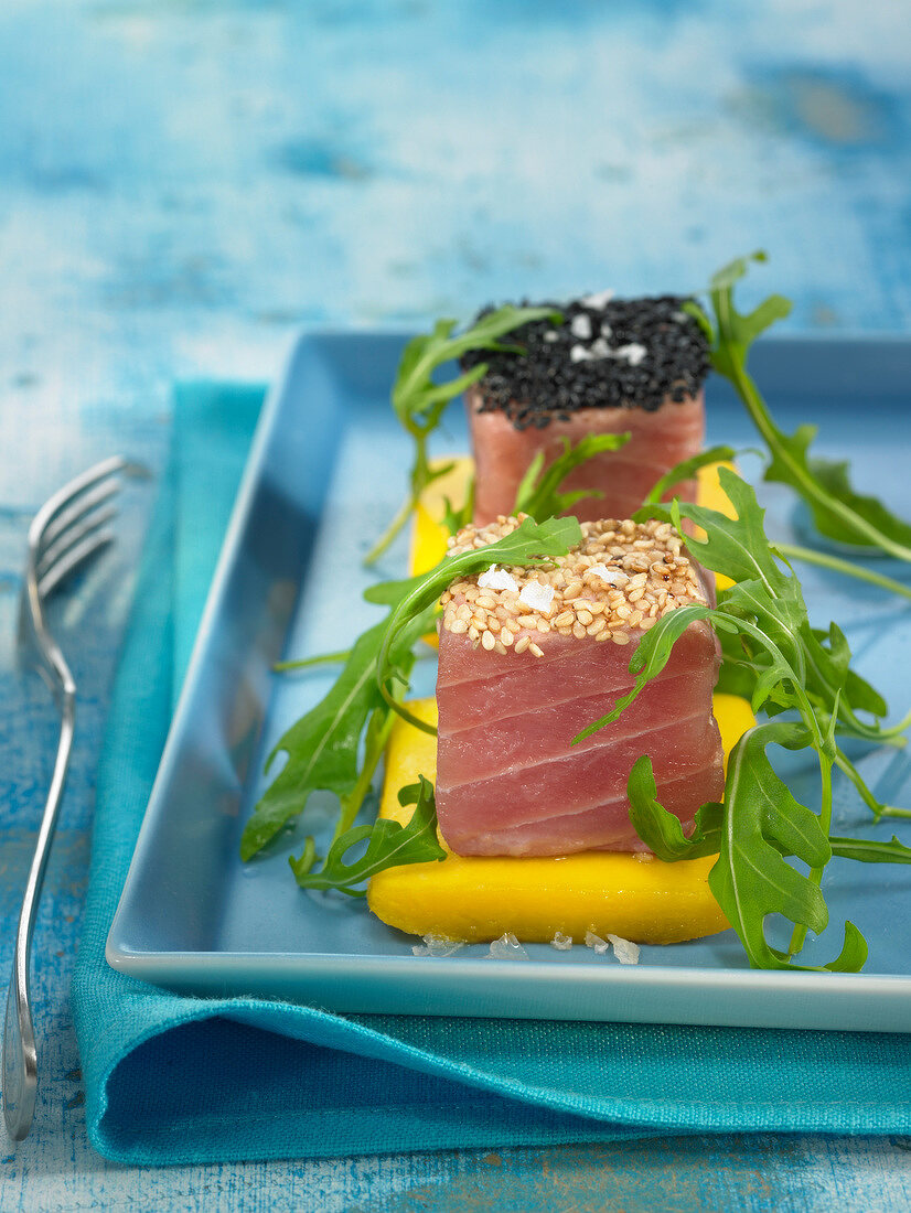 Fresh tuna, mango, rocket lettuce and black and golden sesame seed appetizers