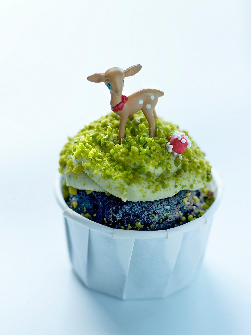 Kid's chocolate cupcake with white chocolate and pistachio cream topping