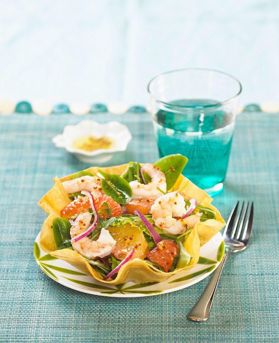 Citrus fruit and shrimp salad in a tuile casing