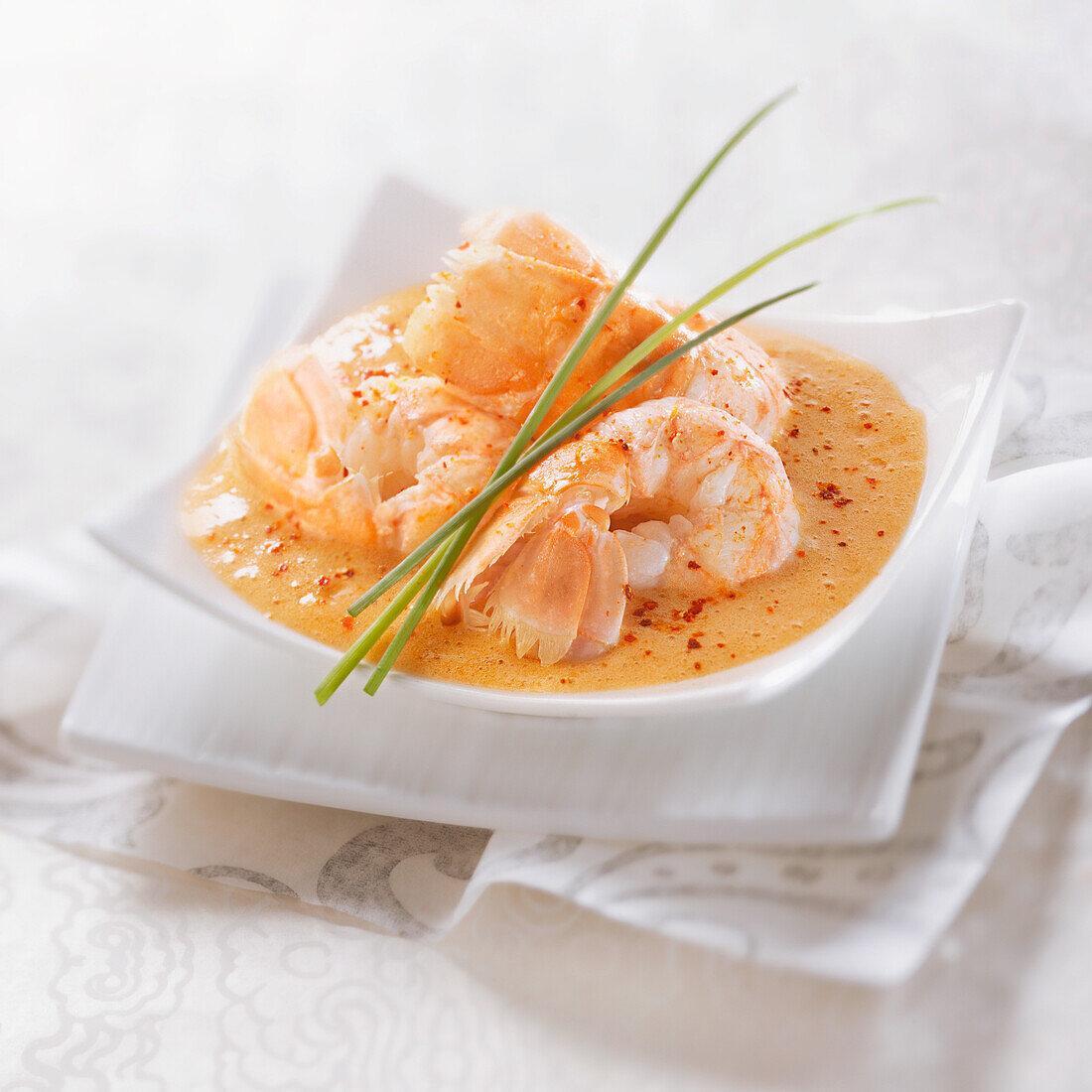 Roasted Dublin Bay prawns with foamy lobster sauce