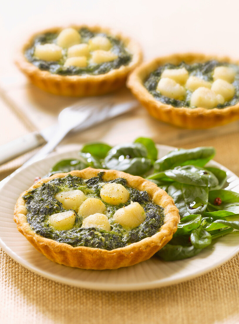 Spinach and petoncle scallop tartlets