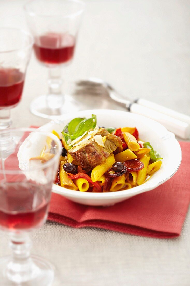 Filet mignon, penne with chorizo, olives and tomatoes