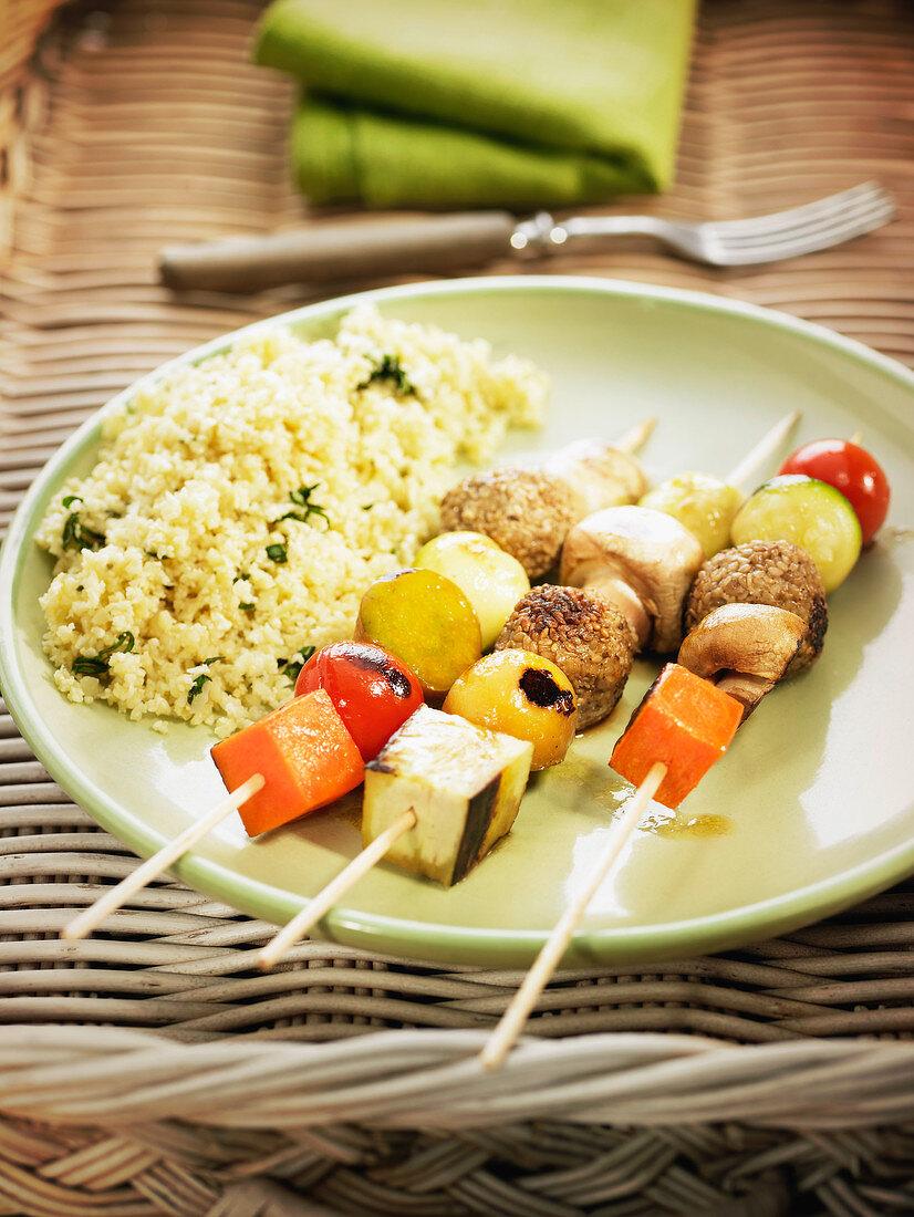 Tofu coated in sesame seeds and vegetable brochettes,cauliflower semolina