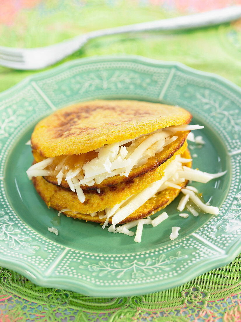 Sweet corn and carrot galettes with grated cheese