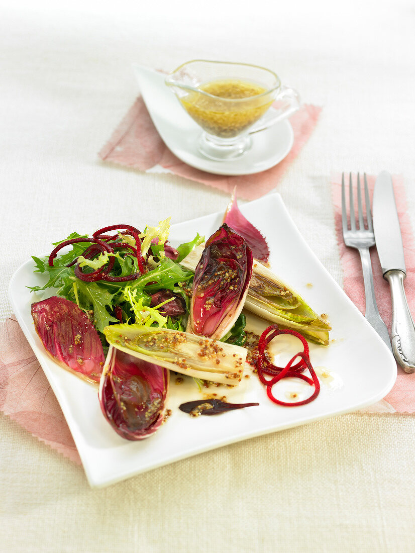 Red and yellow chicory salad with mustard sauce