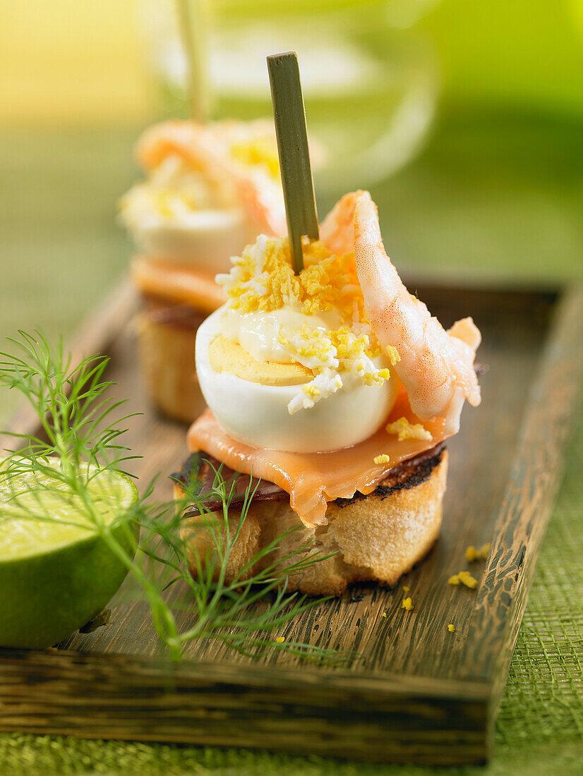 Spanish ham, smoked salmon, shrimp, egg and mayonnaise crostini
