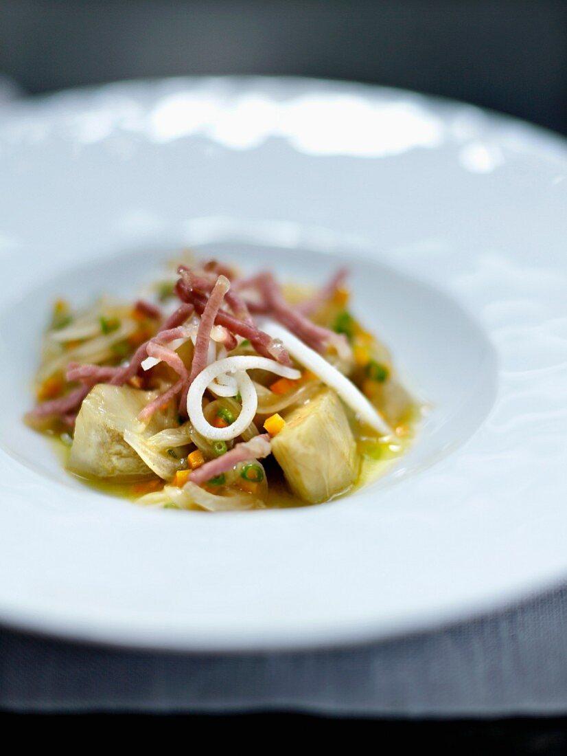 Artichokes a la barigoule with squid and raw ham