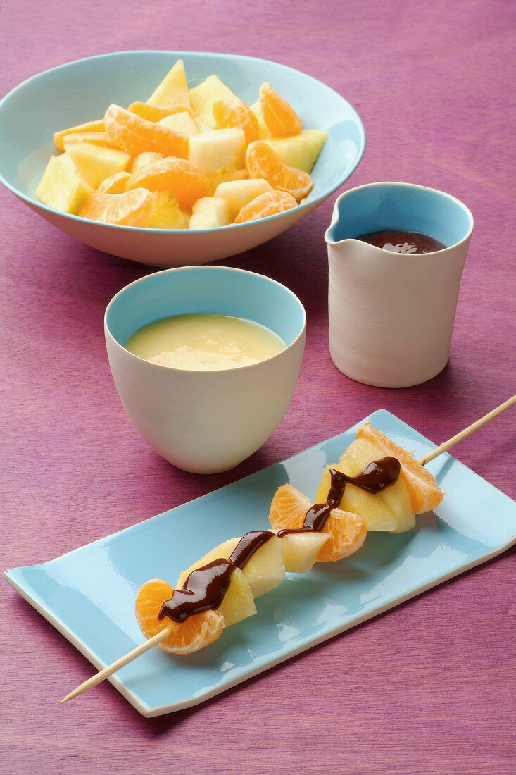 Pear, apple and clementine brochette with two different sauces