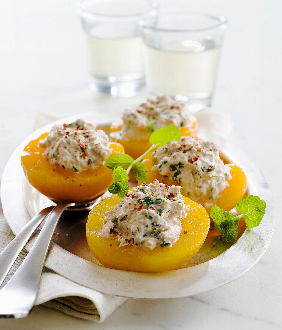 Peach halves filled with tuna