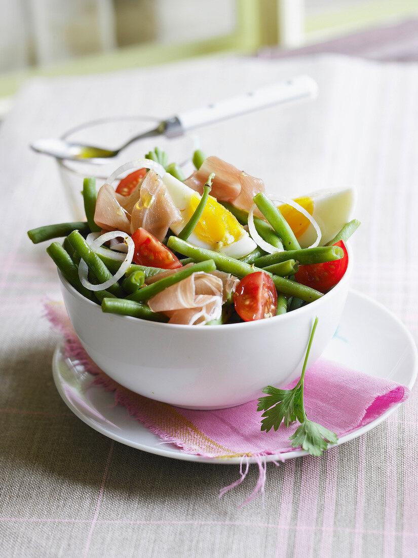 Green bean and raw ham mixed salad