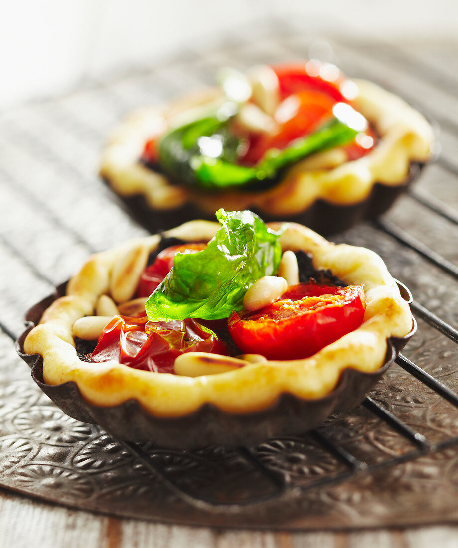 Cherry tomato,tapenade and pine nut tartlets