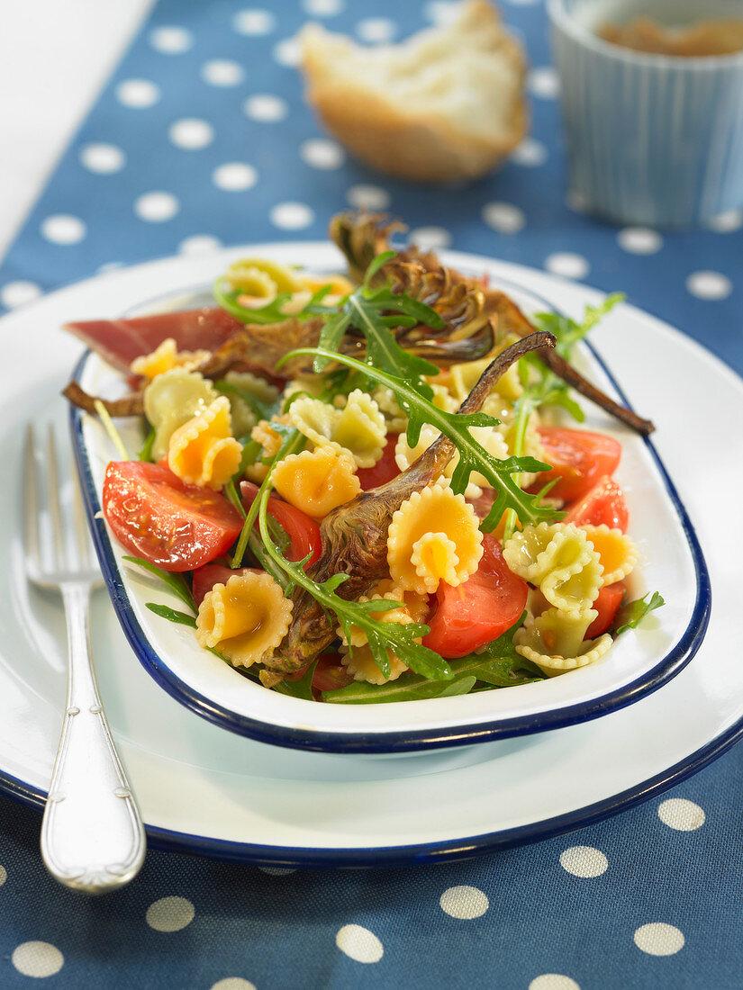 Pasta, rocket lettuce, artichoke, cherry tomato and ham salad