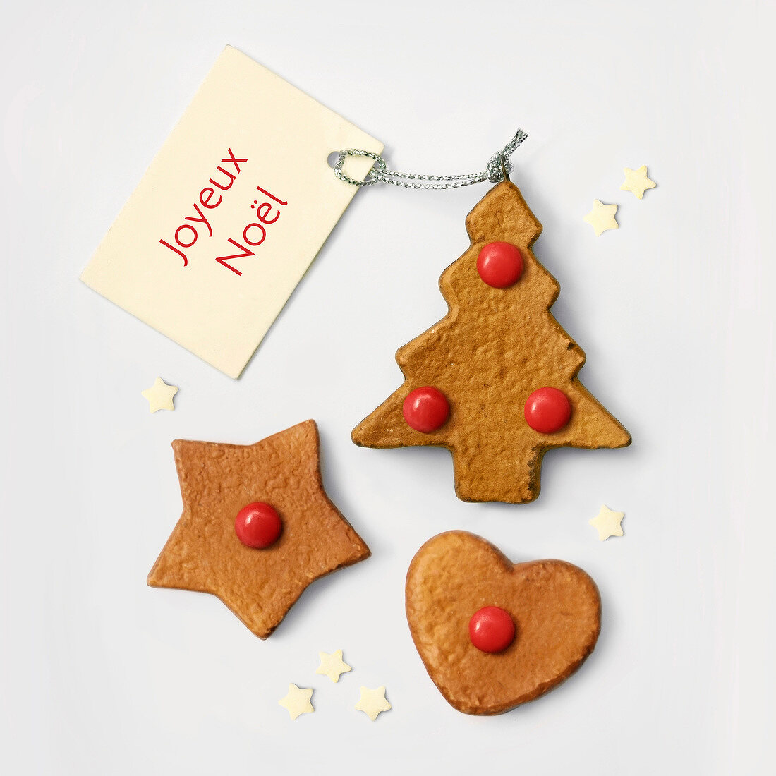 Christmas cookies with red smarties and a Happy Christmas tag