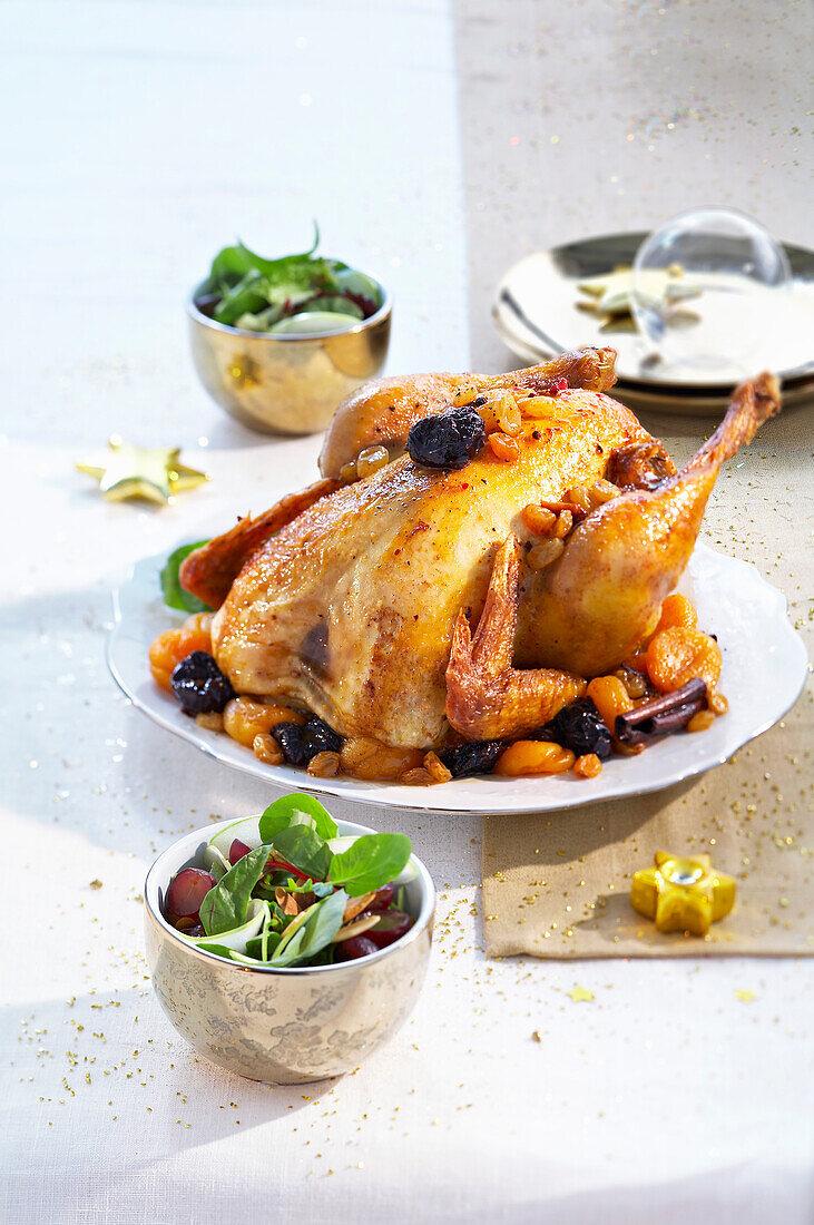 Roast poulard hen with winter fruit,small Christmas salad