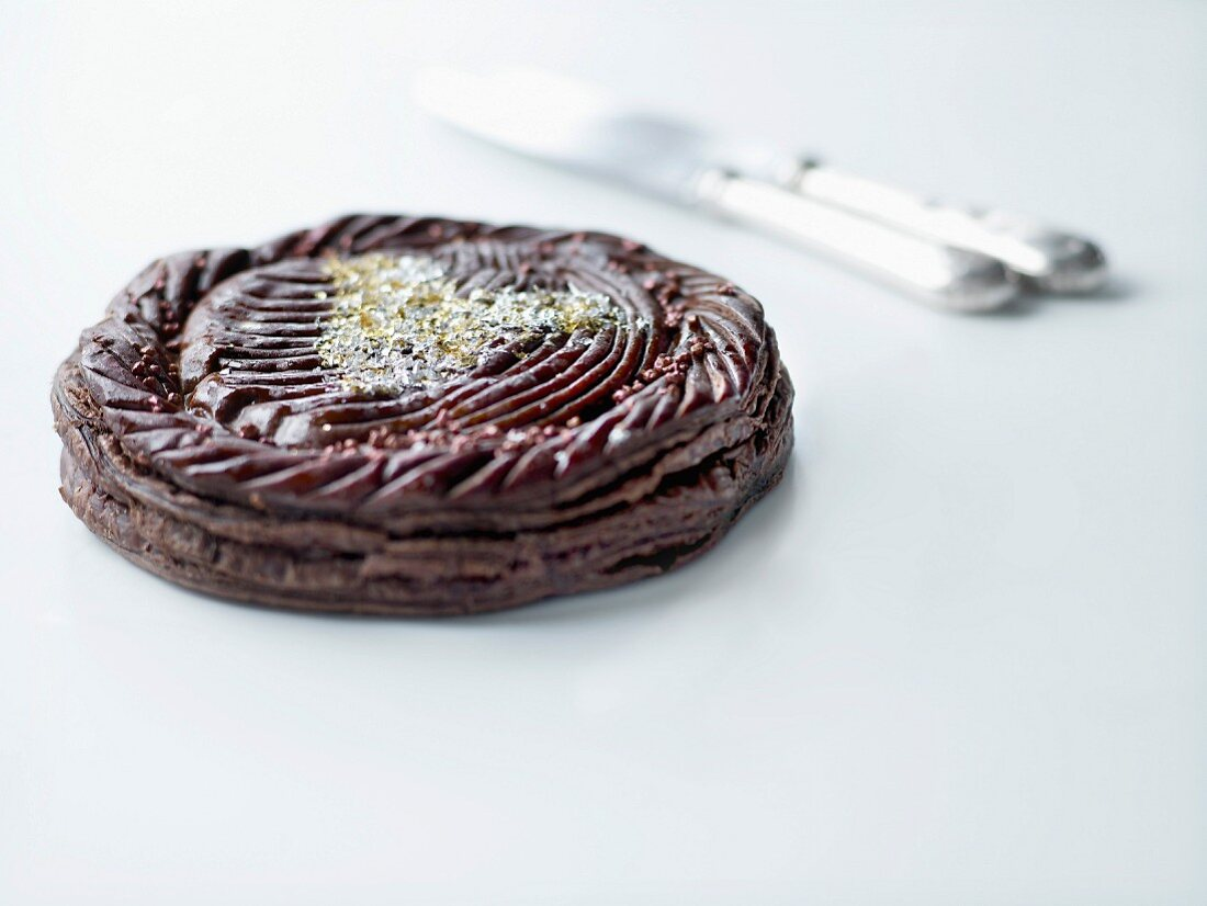 Chocolate Galette des rois decorated with a golden heart