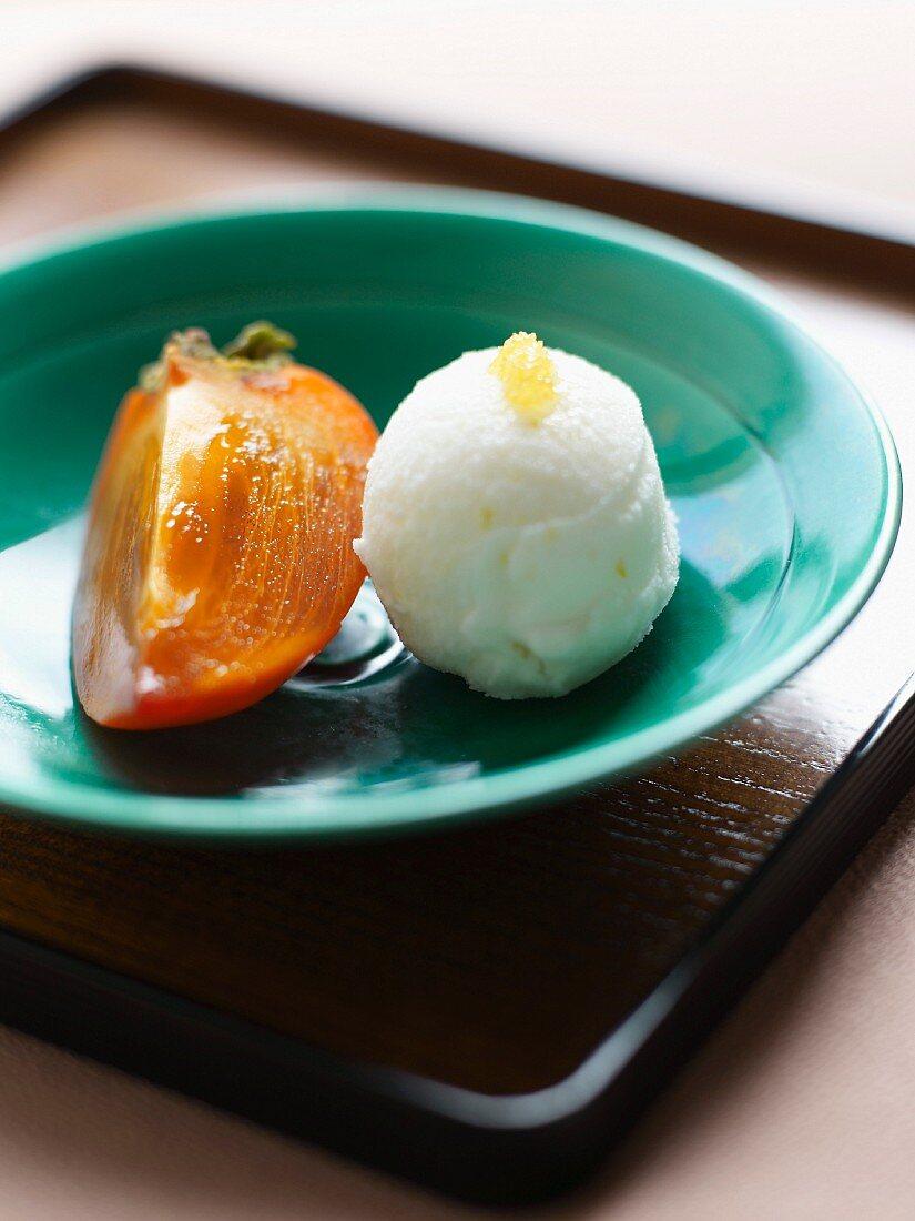 Slice of kaki with yuzu sorbet