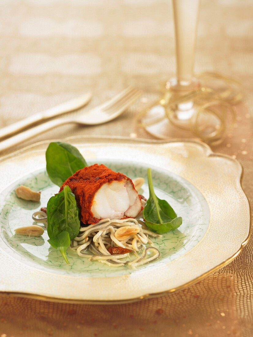Monkfish in paprika crust , small eels