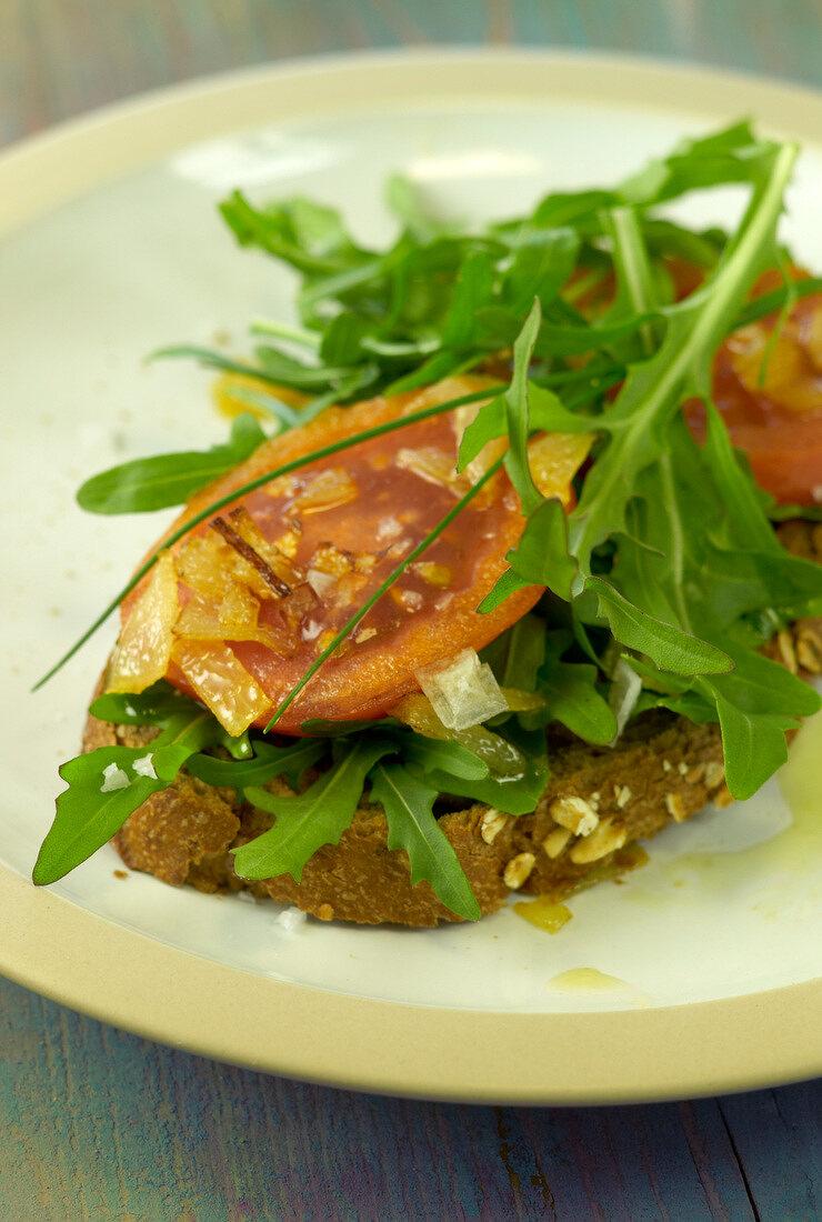 Roasted tomato and rocket lettuce open sandwich