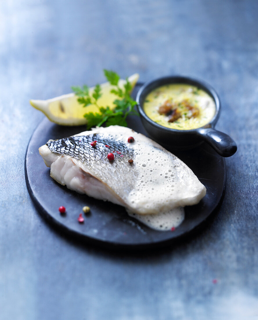Pan-fried sea bass fillet with seaweed foam,patisson flan with crushed chestnuts