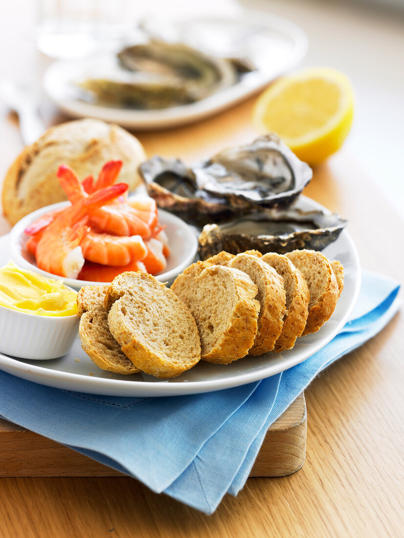 Brown bread with shrimps and oysters
