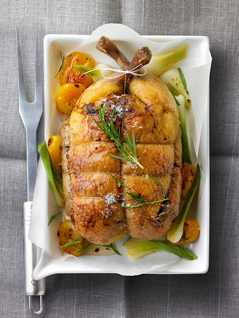 Roast duckling with apricots,spring onions and rosemary