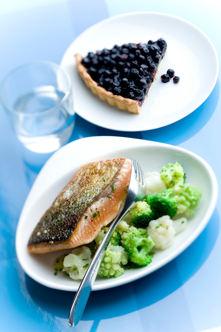 Salmon Tataki with three types of cabbages,slice of bilberry tart