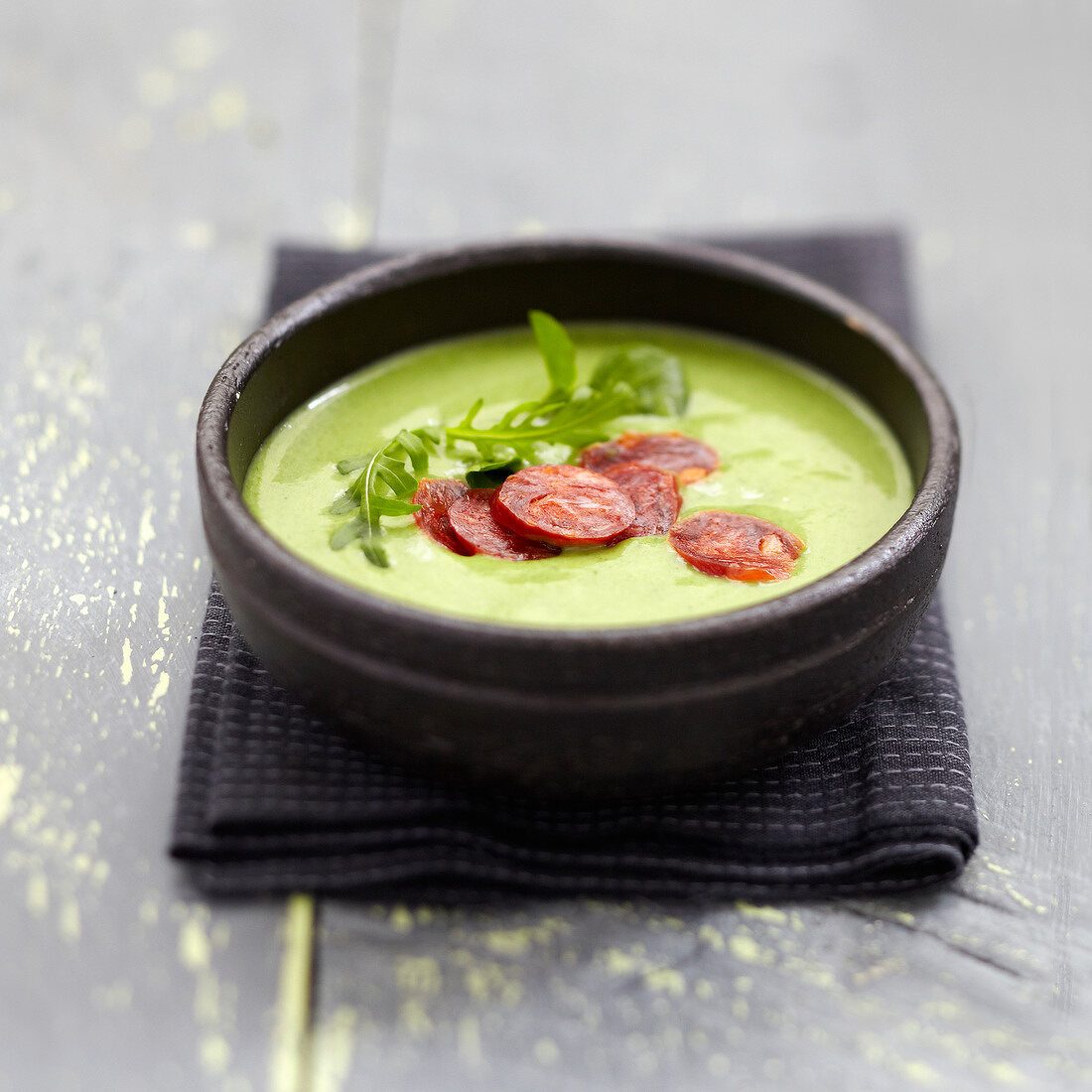 Cream of watercress and rocket lettuce soup with chorizo