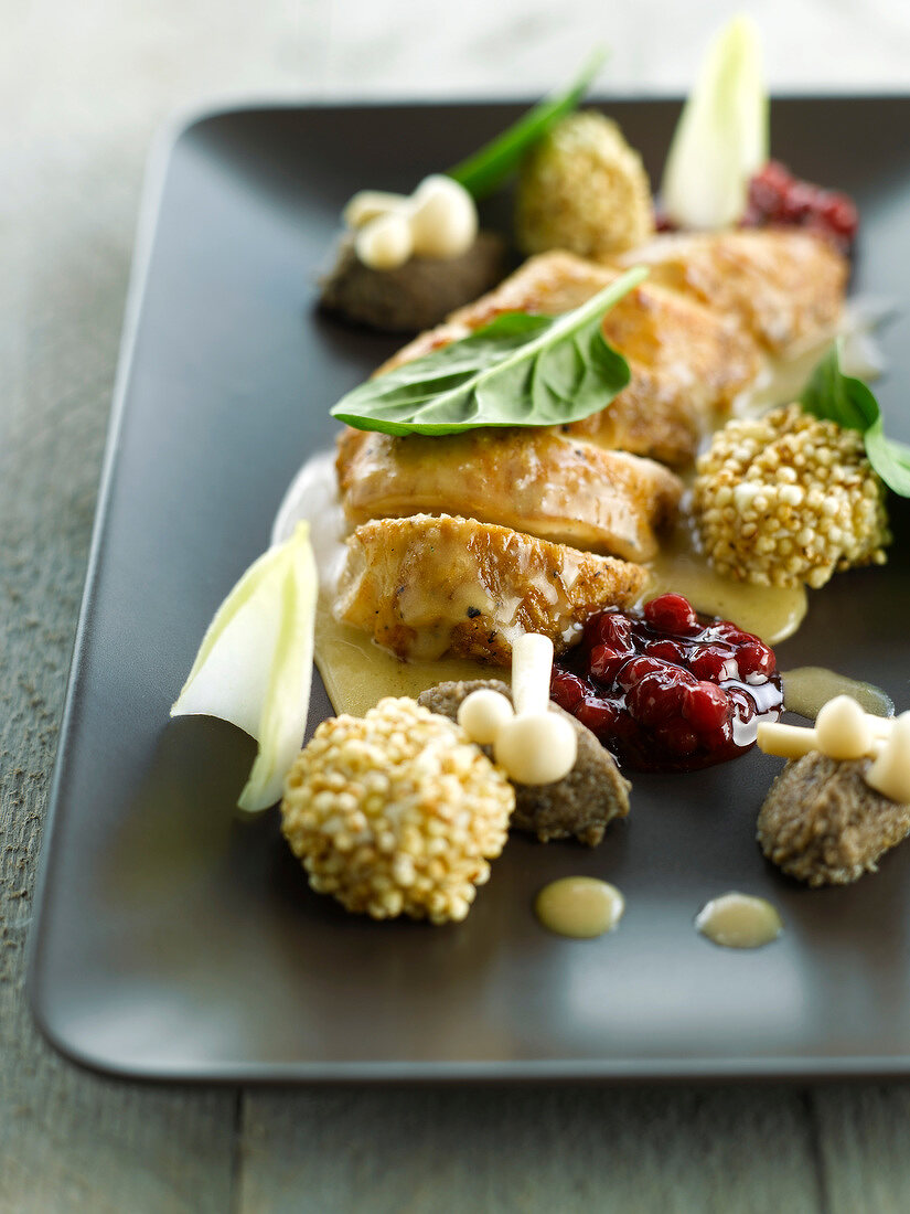 Bresse hen in cider,cranberry sauce,golden mushrooms,anchoyade quenelles and crunchy pearl barley croquettes