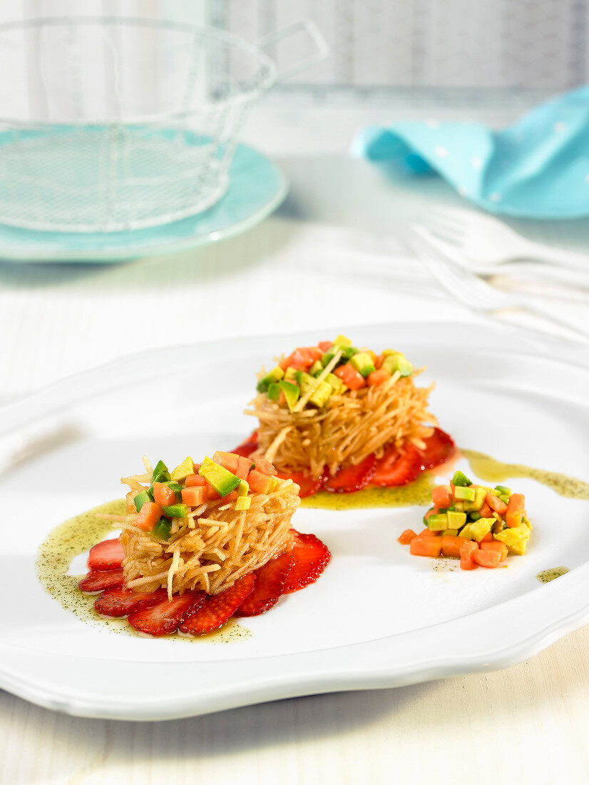 Fruit salad with fried grated potato cakes