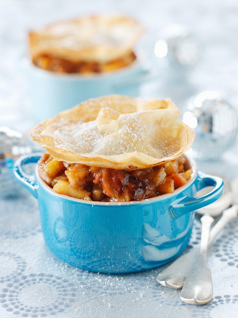 Small casserole dishes of apple-rhubarb with crisp topping