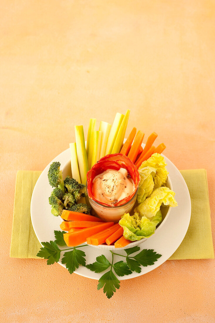 Creamy garlic and spring onion dip with raw vegetables and Chorizo