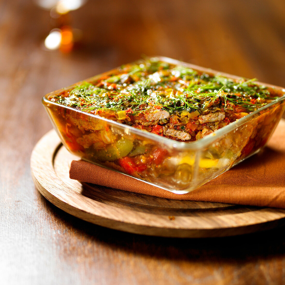Wild boar, pepper and tomato gratin