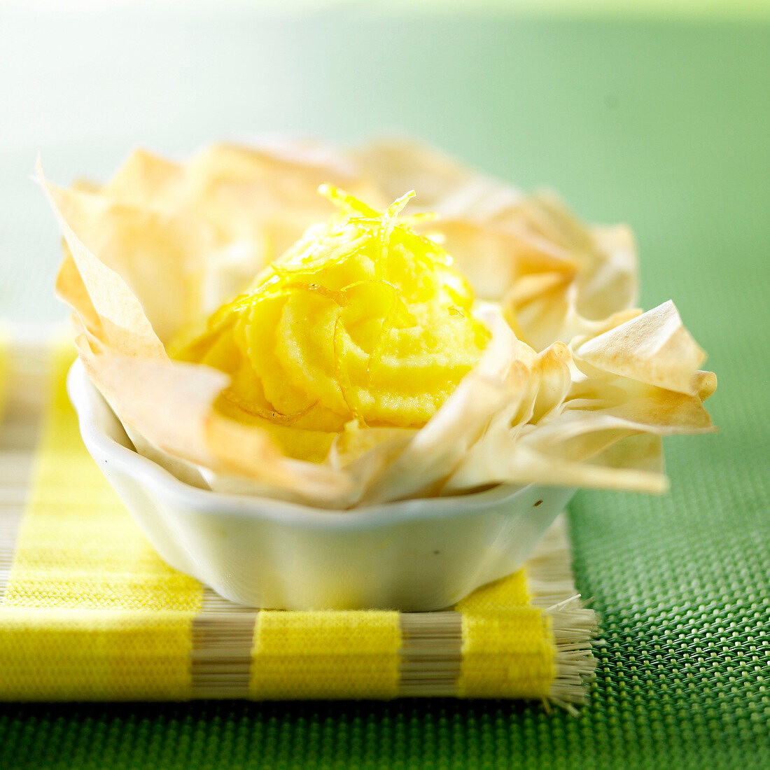 Lemon mousse in a crisy filo pastry tulip