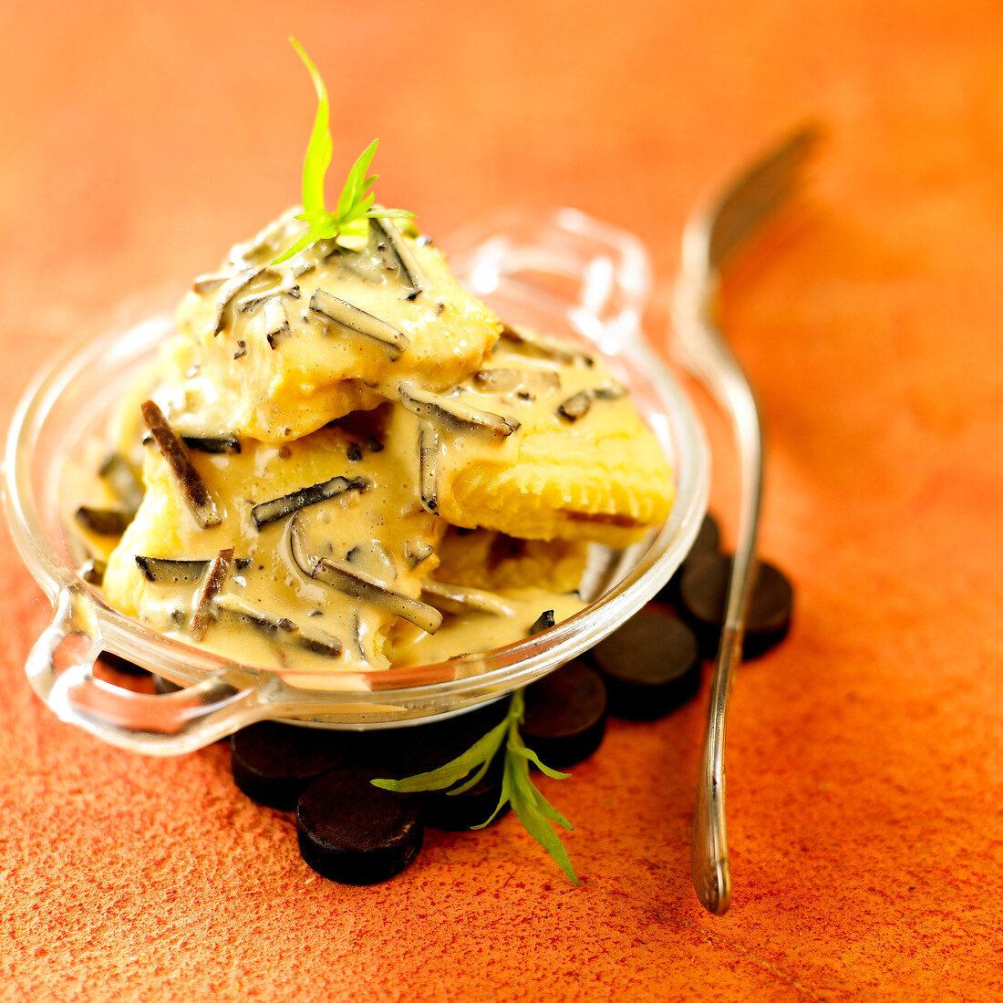Raviolis in creamy truffle sauce