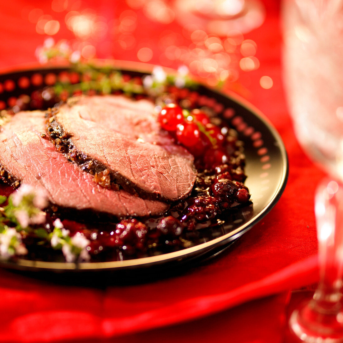 Slices of roasted wild boar with redcurrant sauce