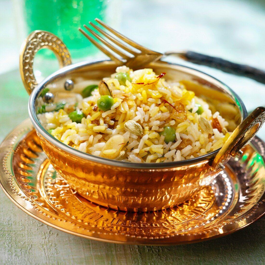 Biryani rice with cardamom, saffron, raisins, peas and almonds