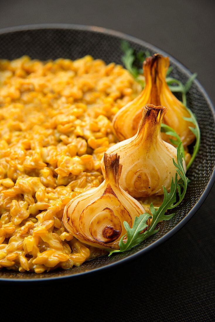 Creamy saffron-flavored barley risotto with spring onions