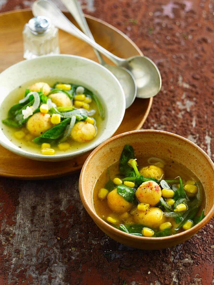 Broth with spinach,sweet corn and polenta balls