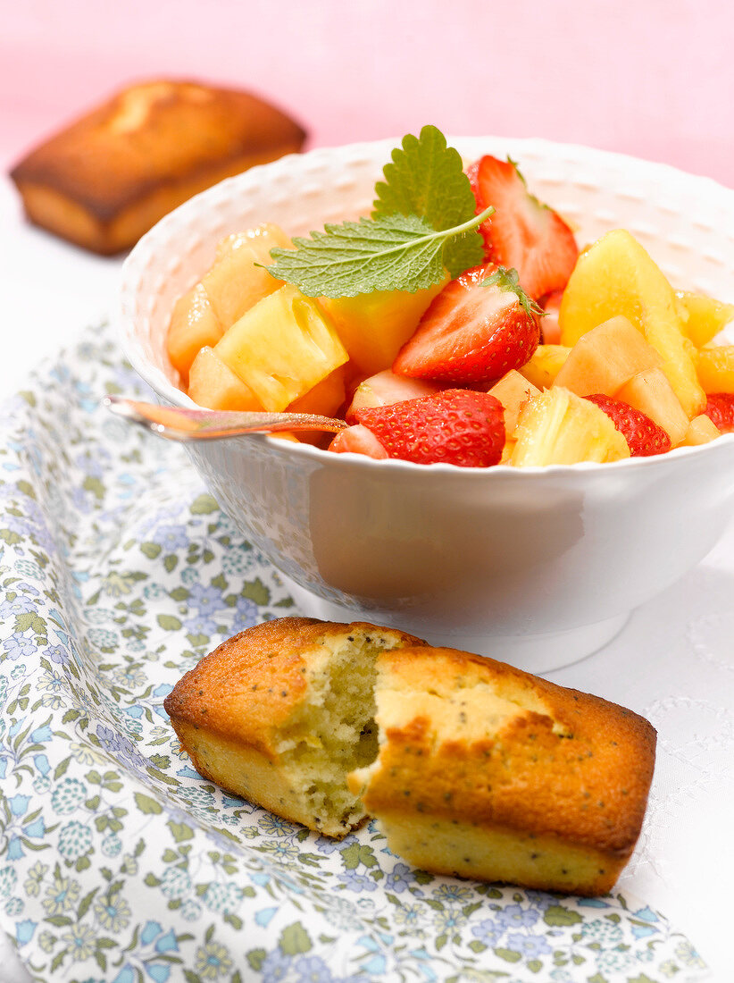 Fruit salad with poppyseed-lemon mini cakes