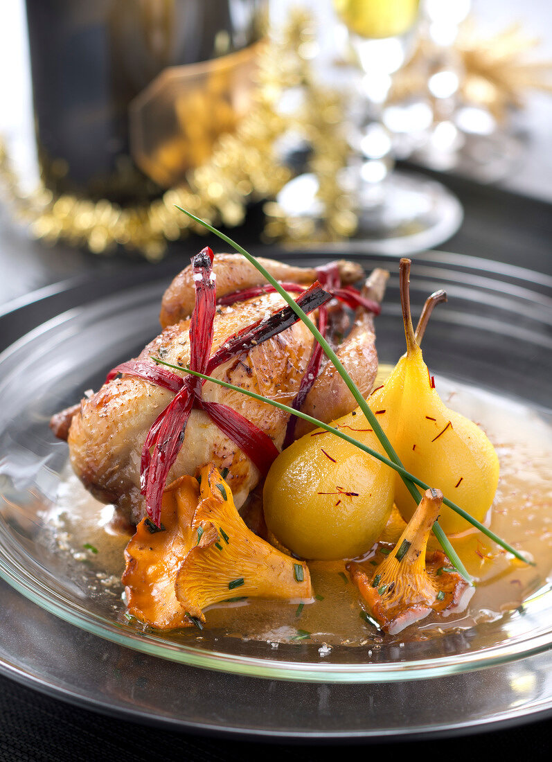 Roasted quail with saffron-flavored pears,chanterelles and honey sauce