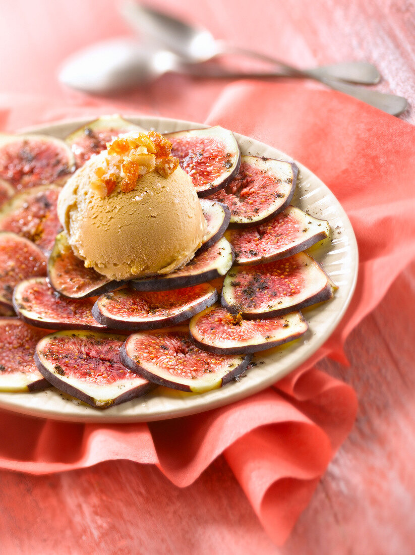 Fig carpaccio and salted butter toffee ice cream with caramelized almonds