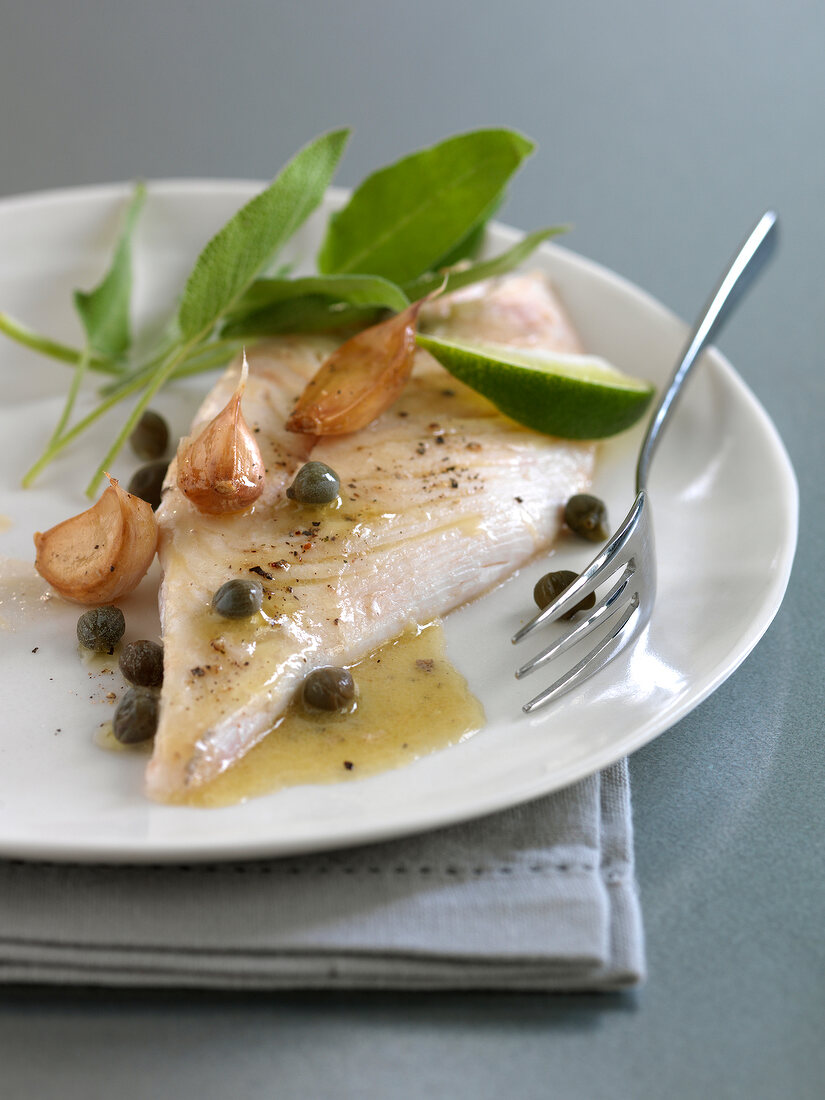 John Dory with caper butter and confit garlic cloves