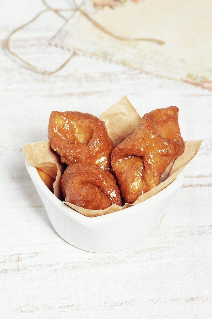 Pestiños (deep-fried Spanish pastries) with honey and almonds