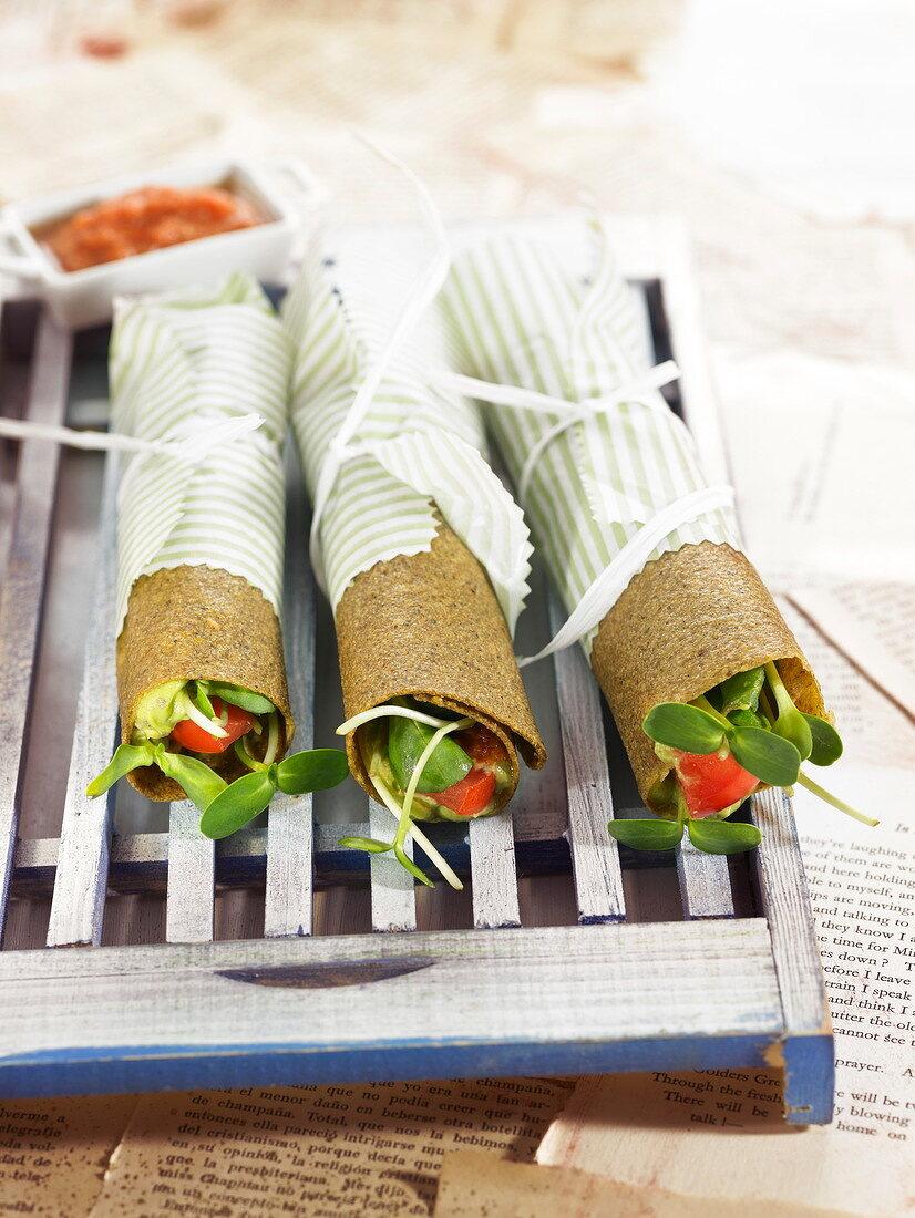 Guacamole and tomato cereal galette rolls