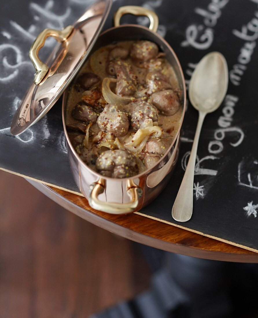Veal kidneys, onion and traditional mustard casserole