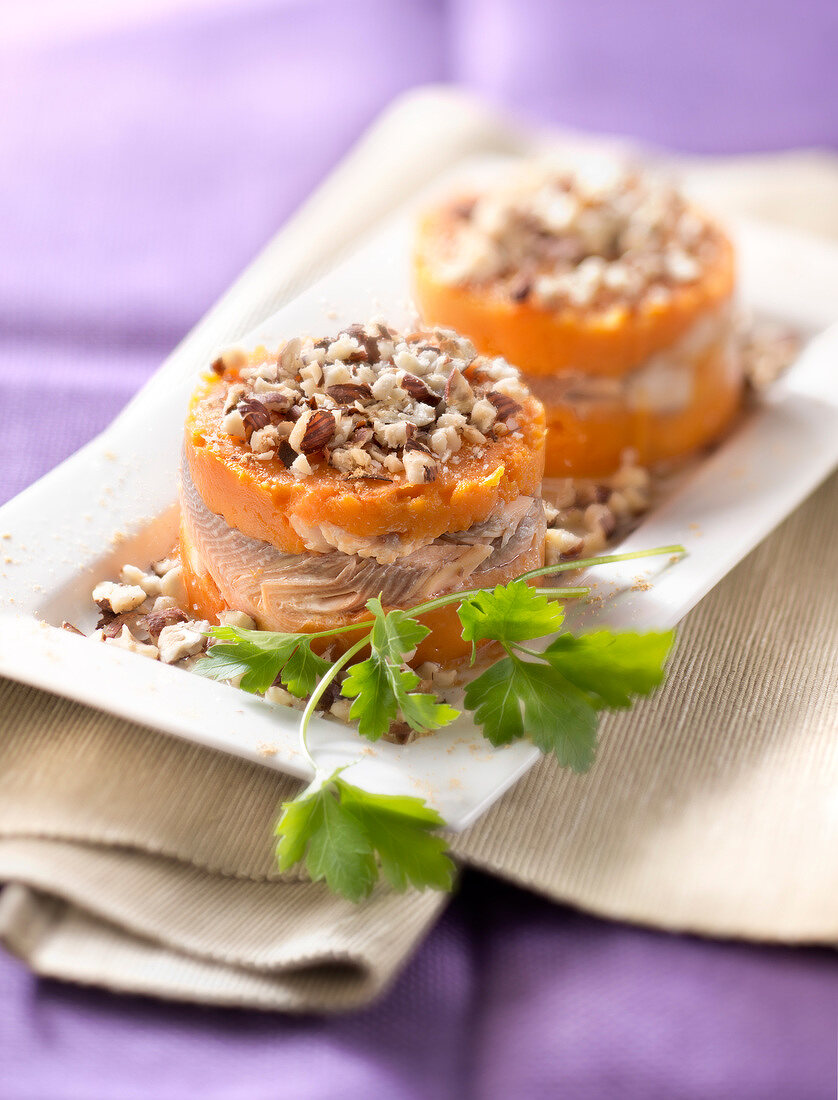 Salmon trout and sweet potato puree topped with crushed hazelnuts