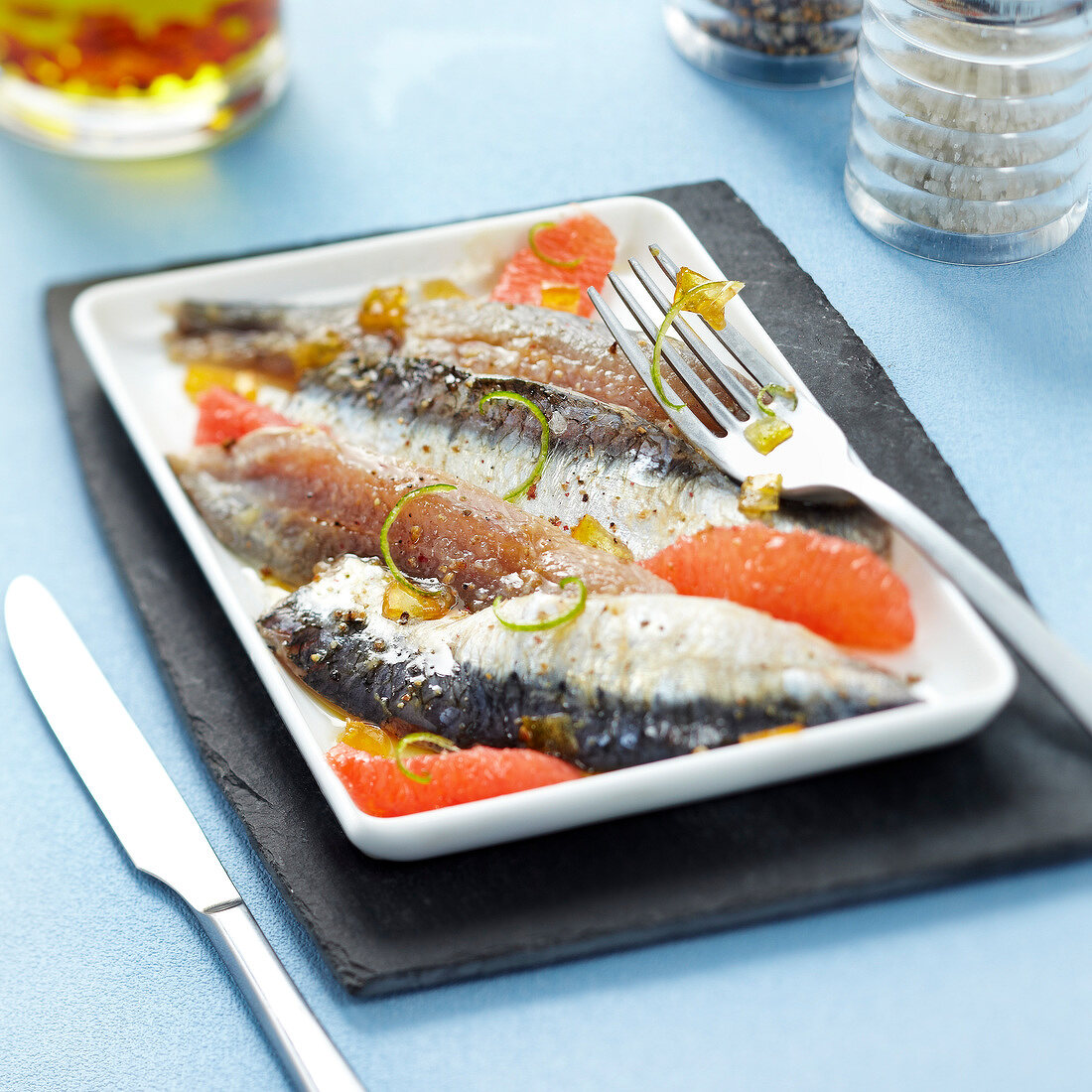 Marinated sardines with grapefruit and lime zests