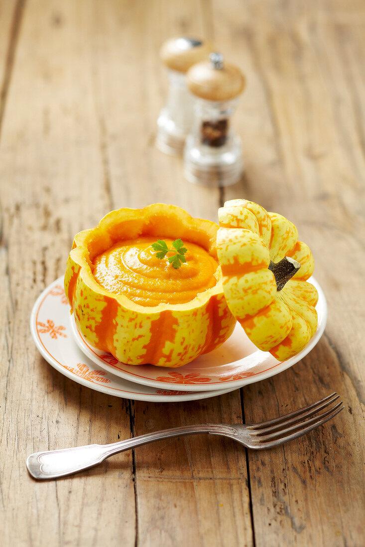Pumpkin puree served in a pumpkin skin