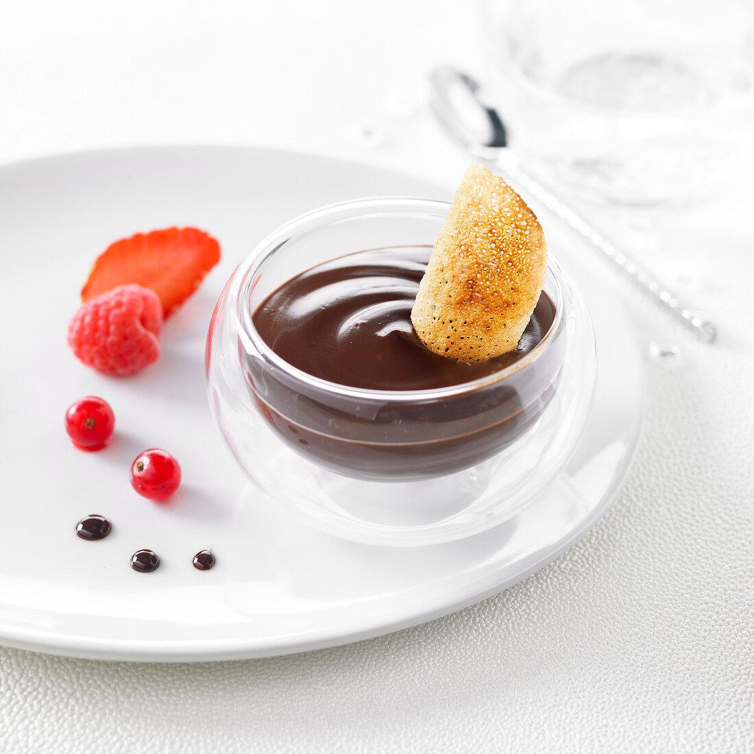 Chocolate cream dessert with a crisp caramellized tuile