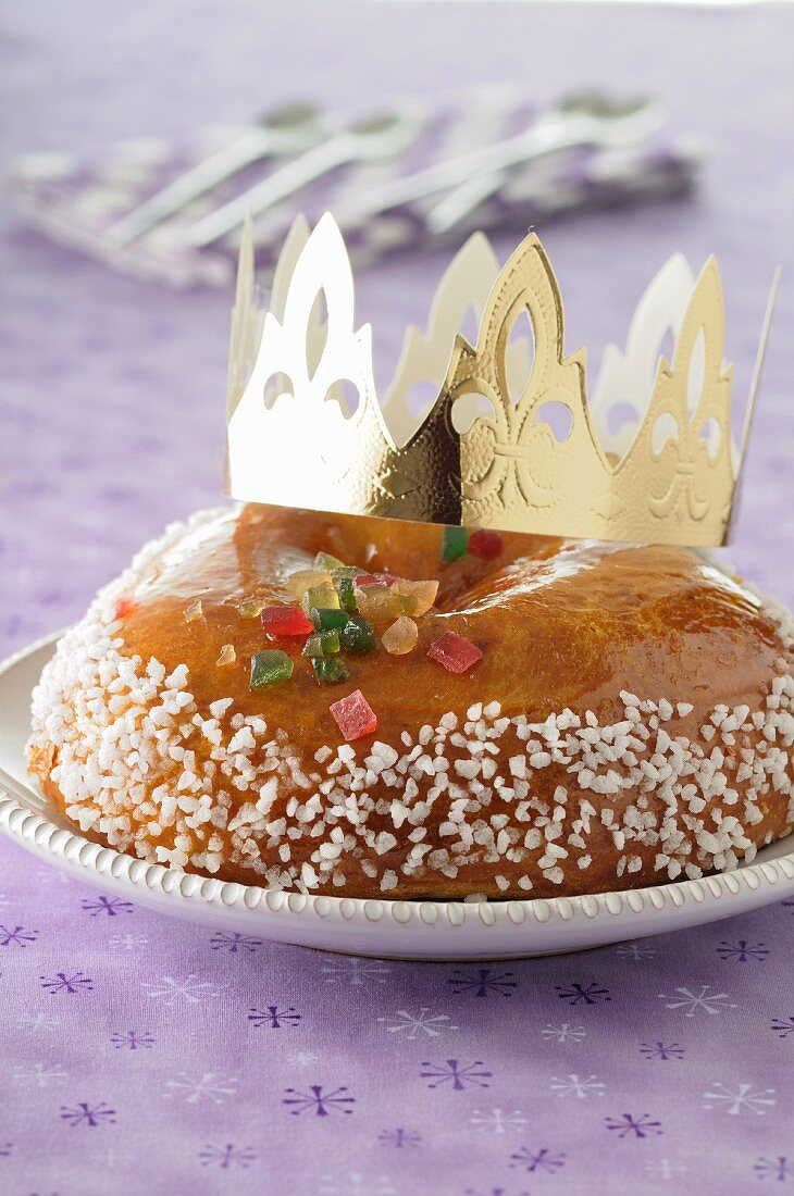 Brioche Galette des Rois with a golden paper crown